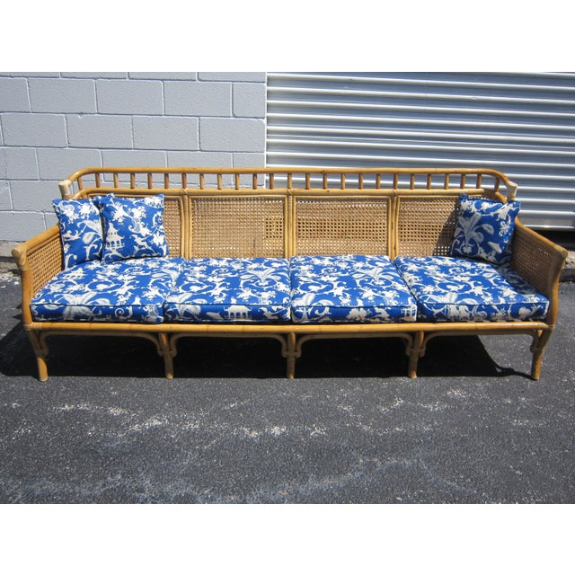 This sofa is a lovely blonde cane and rattan recovered in an Asian inspired indoor/outdoor toile. The sofa has two layers...