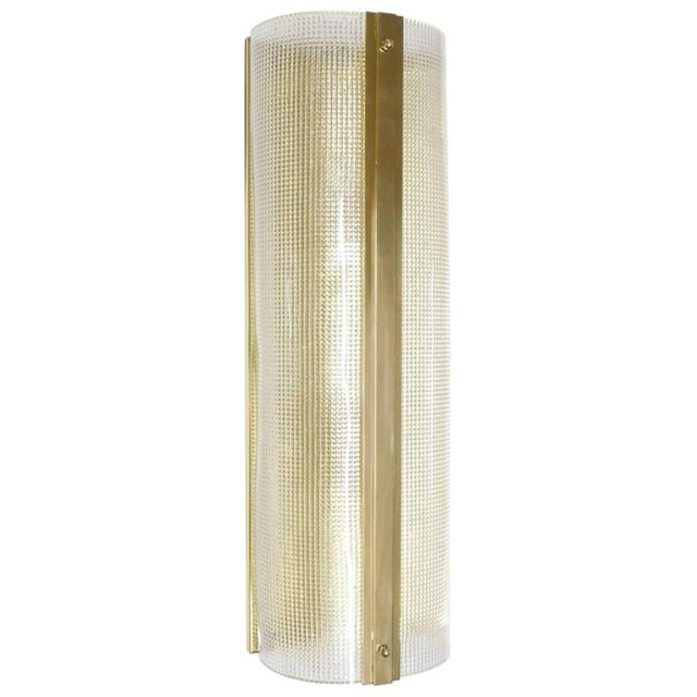 Italian wall lights or flush mounts with clear Murano glasses hand blown in intricate textured patterns in polished brass...