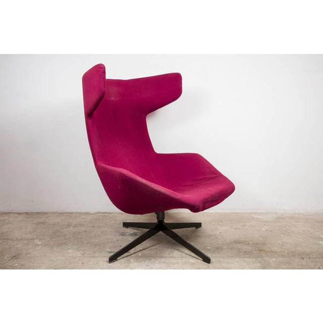A high back lounge armchair designed in 2002 for Moroso by Alfredo Haberli, Italy On the outside it's all precise, orderly...