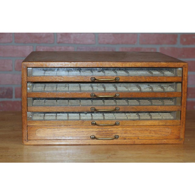 Vintage spool display cabinet. This J&P Coats Cotton spool display cabinet dates back to the early 1900's. It is made of...