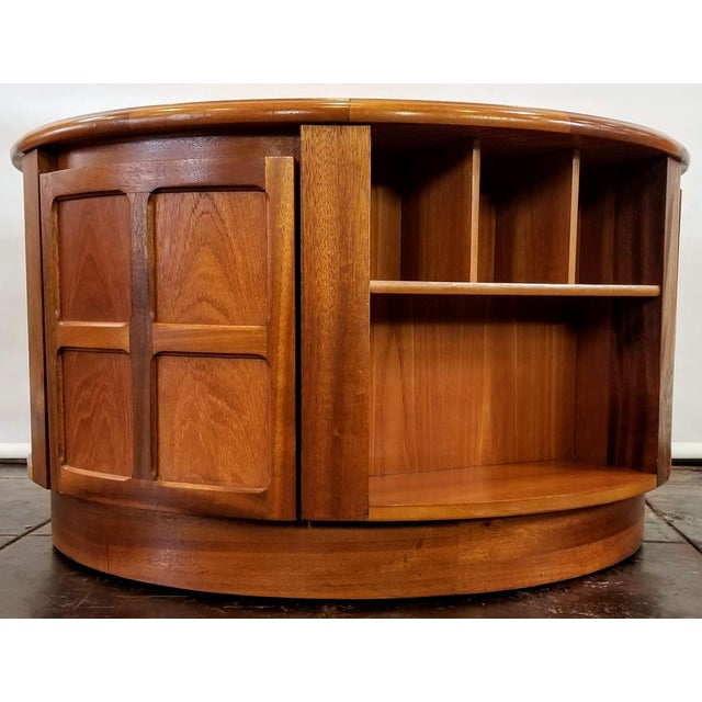 Nathan Furniture Teak Finish Range round occasional table with storage cabinets and shelves is useful as a coffee and...