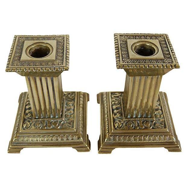 Pair of English brass square column candleholders. No maker's mark. Light wear.