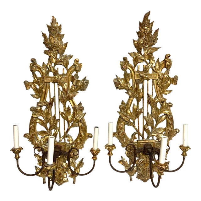 Pair of French Carved Giltwood Lyre Motif Three Light Wall Sconces For Sale