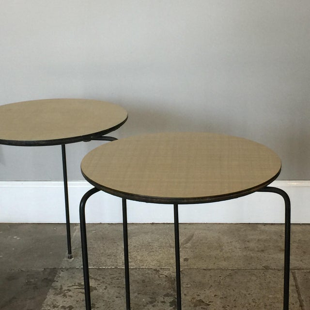 Pair of slender tripod laminate side tables with Lucite details. The top is 14.5 in. diameter.