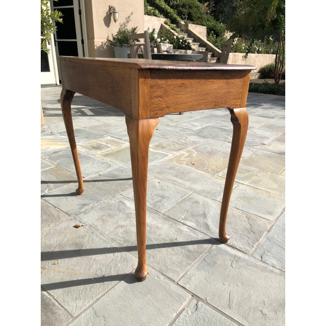 Antique English tea table circa 1880. European Oak with beautiful graining and surface patina. Well proportioned cabriole...