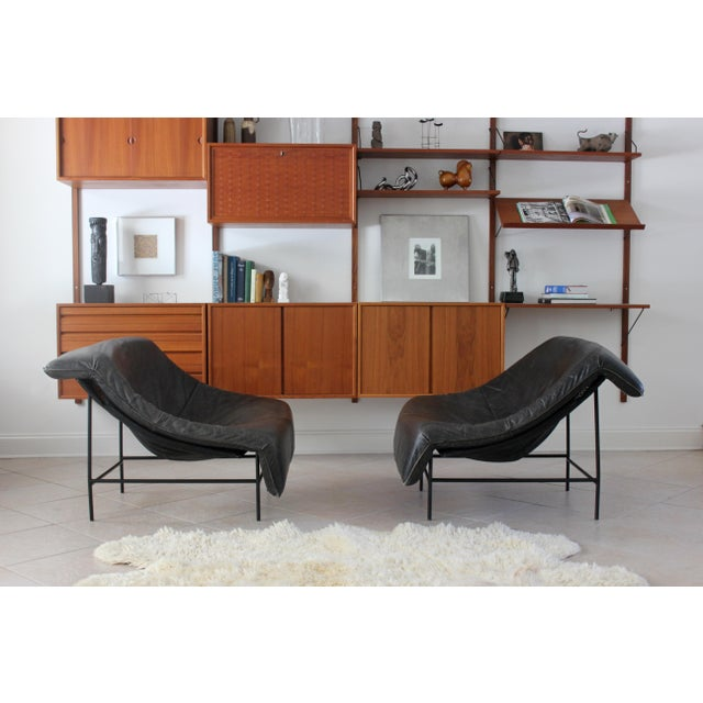 Gorgeous set of two, Butterfly lounge chairs with painted steel base and black leather cushion by Gerard van den Berg for...