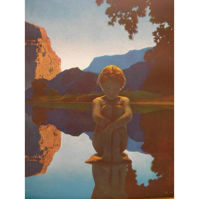 An original period print of Maxfield Parrish's painting 'Evening' published by Reinthal & Newman in a period conforming...