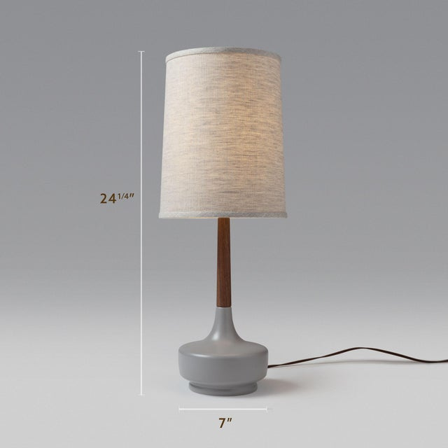 Grey Ceramic Base, Walnut Wood Neck, Oatmeal Muslin Lampshade Thoughtful attention to detail went into the making of this...