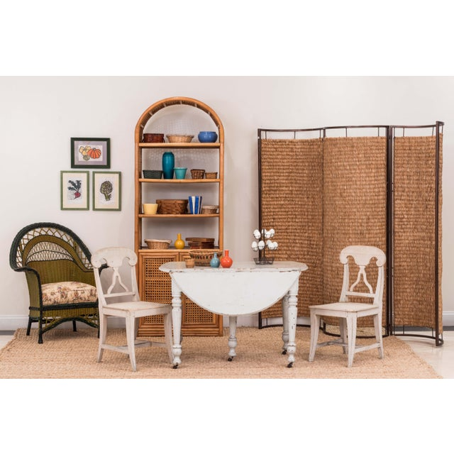Italian Mid-Century three concave panel woven rattan screen with a painted brown metal frame (per panel measurement).