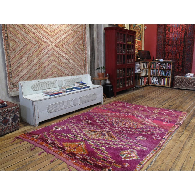 A wonderful old Moroccan rug from the western foothills of the Middle Atlas Mountains with a whimsical design and great...