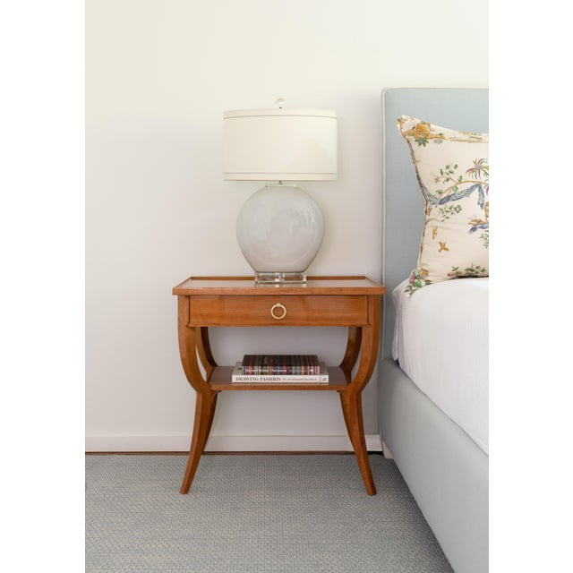 Crafted from traditional cherry wood, the Estelle Side Table's silhouette goes unmatched. Offering a single drawer, large...