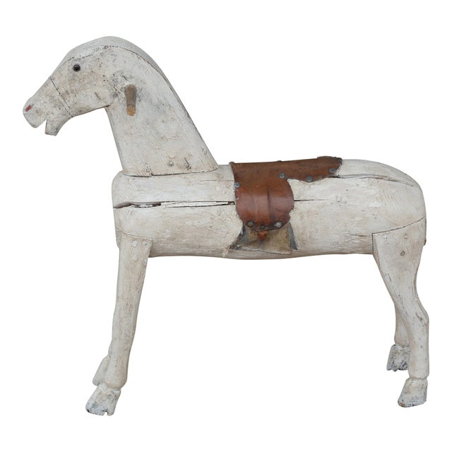 19th century carved and painted Folk Art toy horse with leather saddle from Sweden.