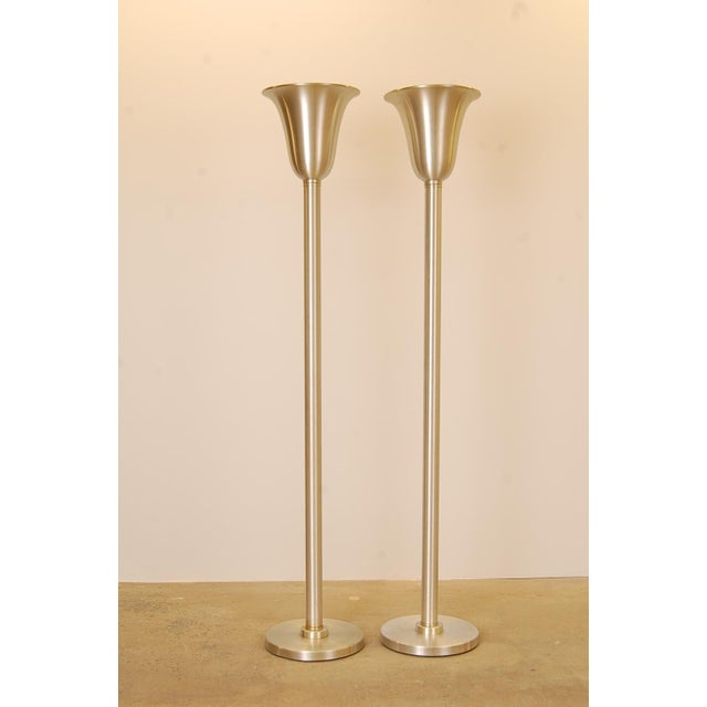 Classic pair of spun aluminum torchieres attributed to Russel Wright, circa 1947. In absolutely amazing condition for...