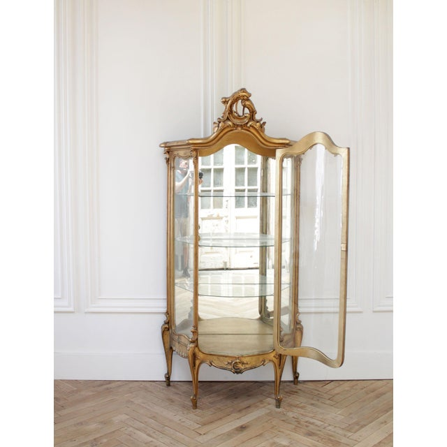 Early 20th Century Louis XV Style Giltwood Carved Vitrine Display SKU Number: 8211-9912009 Description: Early 20th century...