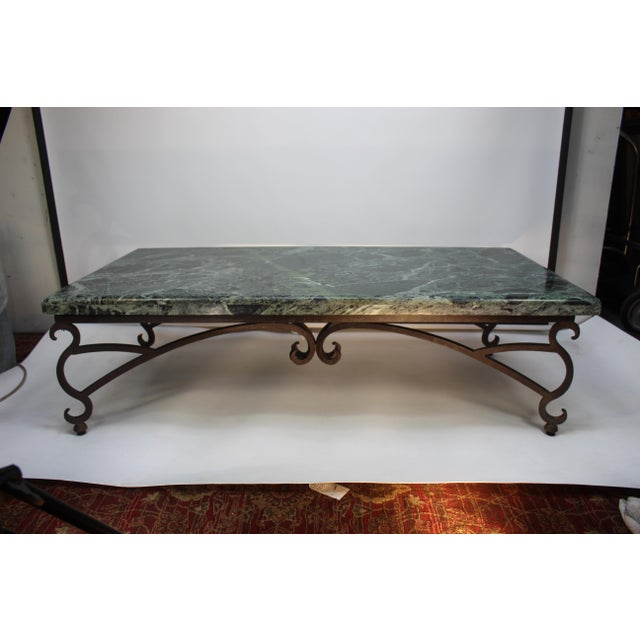 Beautiful green mid-century modern or contemporary Italian marble coffee table with wrought iron vines as a base. Subtle...
