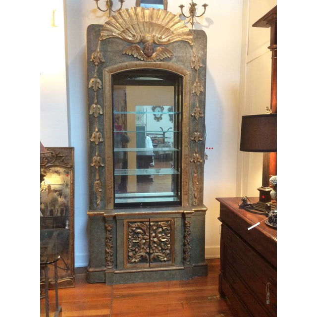 Over the top painted and Gilt decorated mirror backed display Cabinet with antique fragments. The bottom cabinet has two...