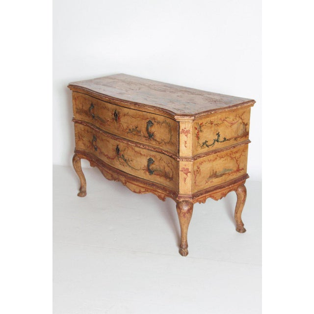 Mid 18th century Italian painted two drawer commode with floral decoration. A serpentine molded top with canted sides and...
