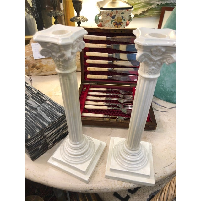 Exquistie Creamware set of candleholders with intricate detailing.