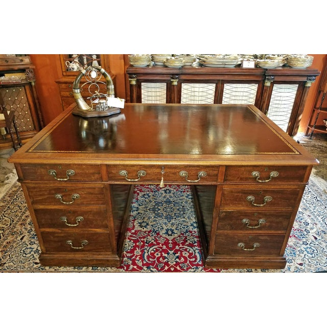 Presenting a beautiful British flame mahogany and tooled leather partners desk, Regency William IV period, circa 1835....
