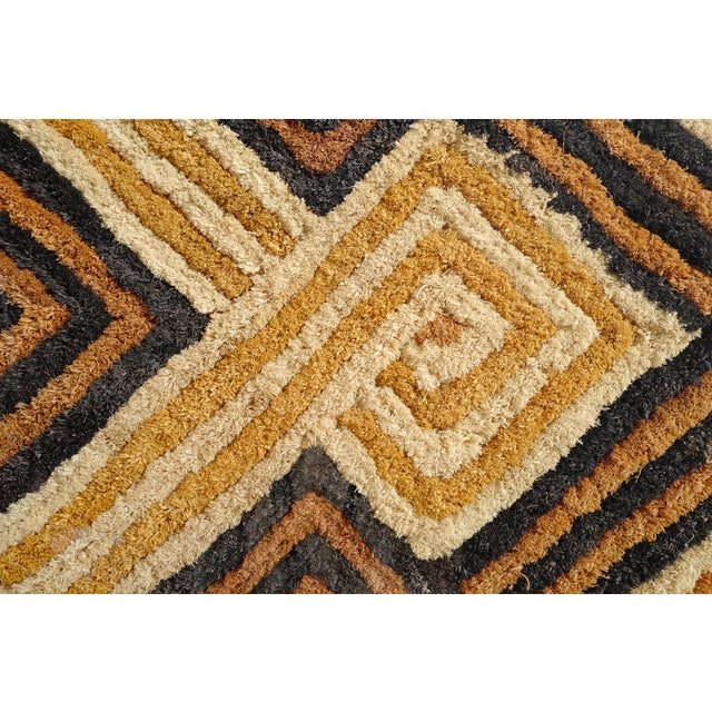 Authentic Kuba raffia grass cloth Shoowa mat. Beautifully framed floating on black linen ground. Simple black wood frame...
