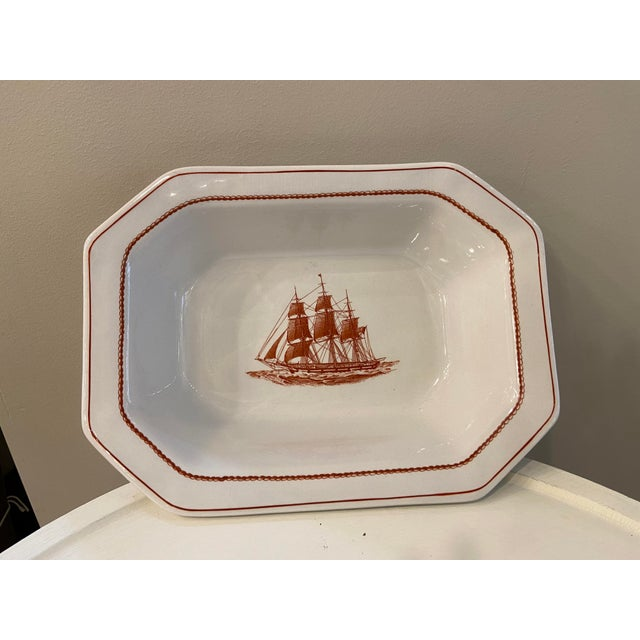 This is a beautiful serving dish. It has an octagonal base and is great for vegetables. It is made by Wedgwood in England....