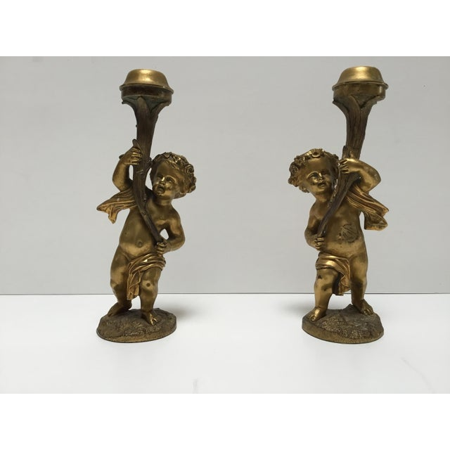 Beautiful pair of 19th century French Bronze dore cherub candlesticks. They are quite heavy, each one weighing 3 lbs 5 oz....
