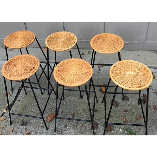 """1970's Iron bar well made wrought iron stool with rattan woven seat, rubber feet tips, sturdy, top seat diameter is 12""""...."""
