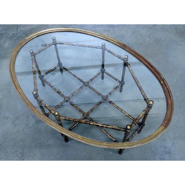 Faux bamboo tray top table with a glass insert. This is in good condition with minor oxidation to the metal.