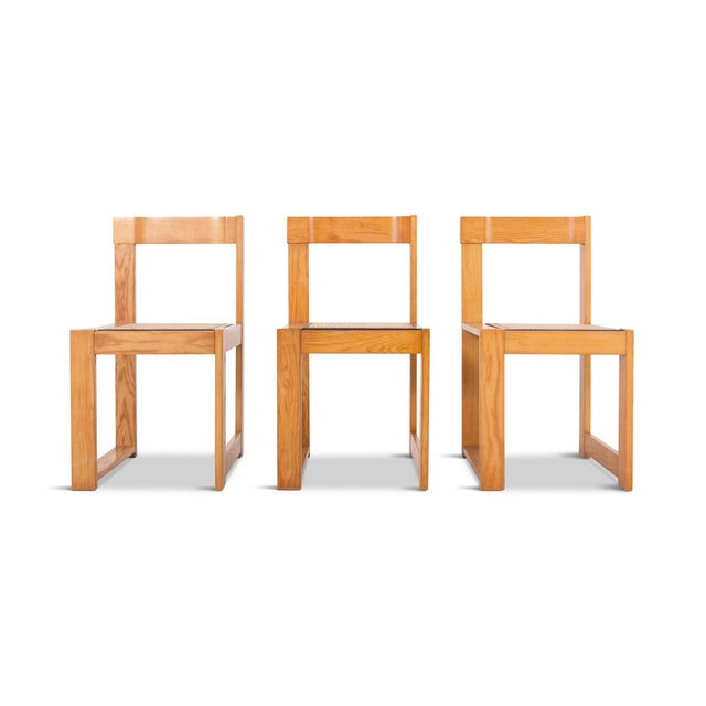 Italian dining chairs from the 1970s from unknown designer. Real good design as the asymmetrical chairs still feel very...