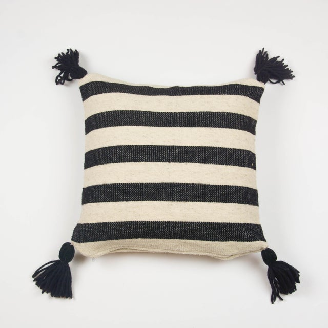 Simple, handwoven throw pillow created by our partners in Central Mexico. The wool is sourced locally and the dying and...