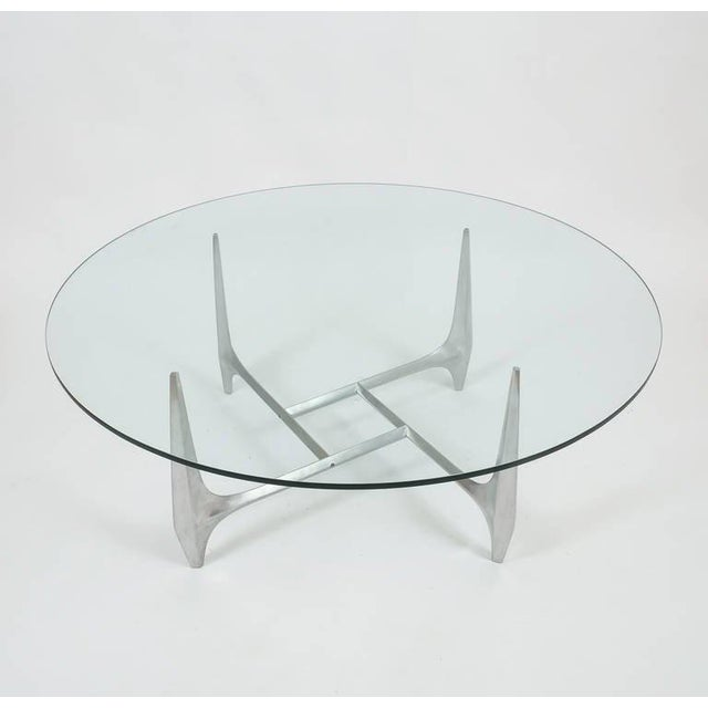 Sculptural coffee or cocktail table by Knut Hesterberg produced by Ronald Schmitt, Germany circa 1960 and composed of...