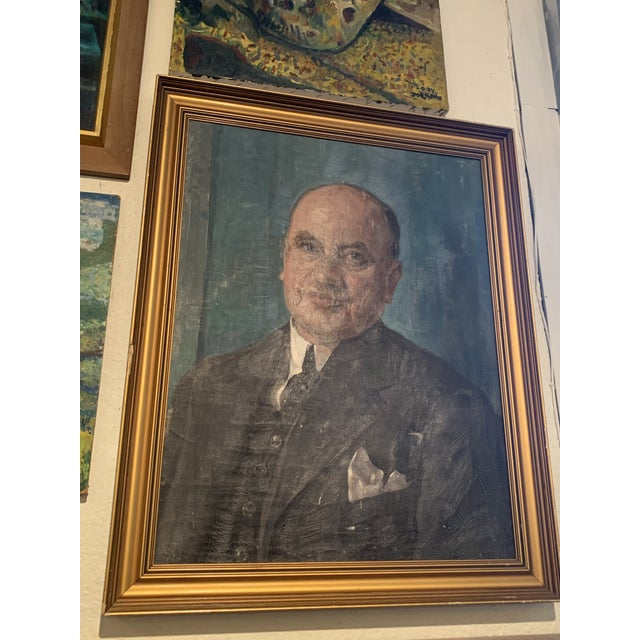 Portrait painting of a man named lon Rasmussen circa 1930s by Bertha Dorff that has a puncture to the canvas in a gold...
