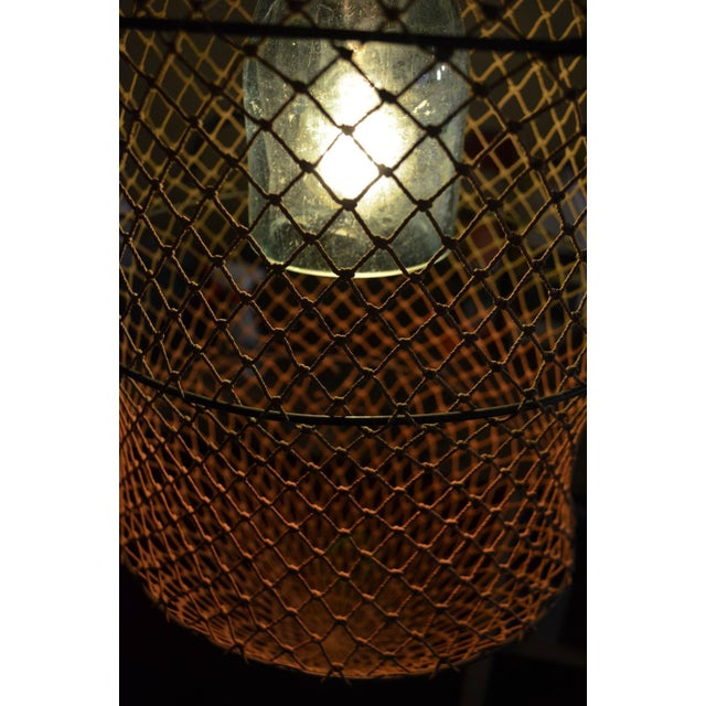 Pendant Light From Seltzer Bottle Inside Fish Trap - Image 5 of 10