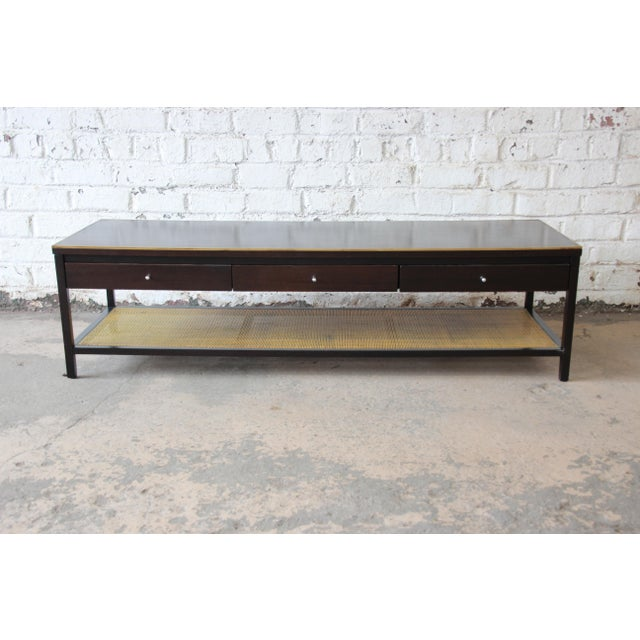 Offering a rare and exceptional mid-century modern two-tier coffee table designed by Paul McCobb for Calvin Furniture's...
