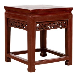 Vintage Chinese Side Table with Dark Red Patina and Foliage Hand Carved Apron For Sale