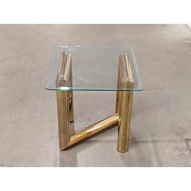 Nice tubular end table by Karl Springer. It is in good vintage condition showing some minore wear to it's finish.