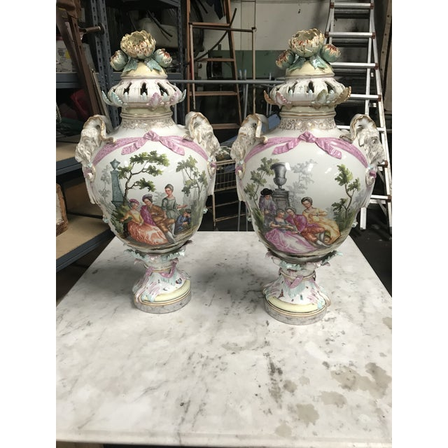 Pair of Large Antique Early 19th Century Porcelain Urns/Vases with Ram Head Handles and elaborate, ornate Covers.