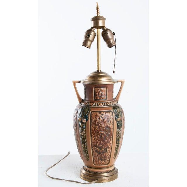 Earthenware lamp, probably American. Circa 1910.