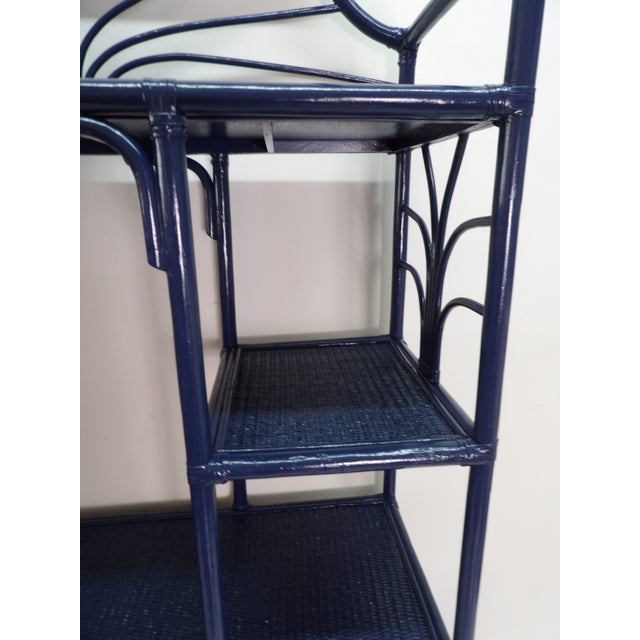 Tall Woven Rattan Etagere in new Navy Blue Lacquer. The Rattan shelves and cabinet door as exceptional and this unit has 5...