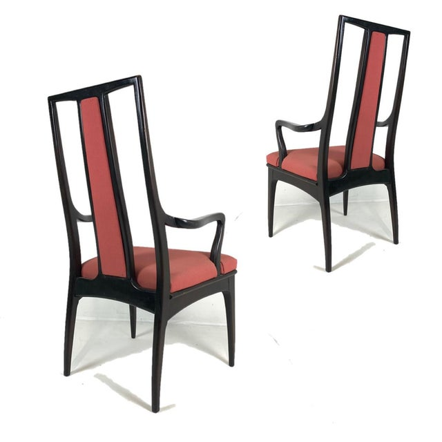 An elegant pair of John Stuart armchairs that could be used as dining or occasional chairs. They have the original dark...