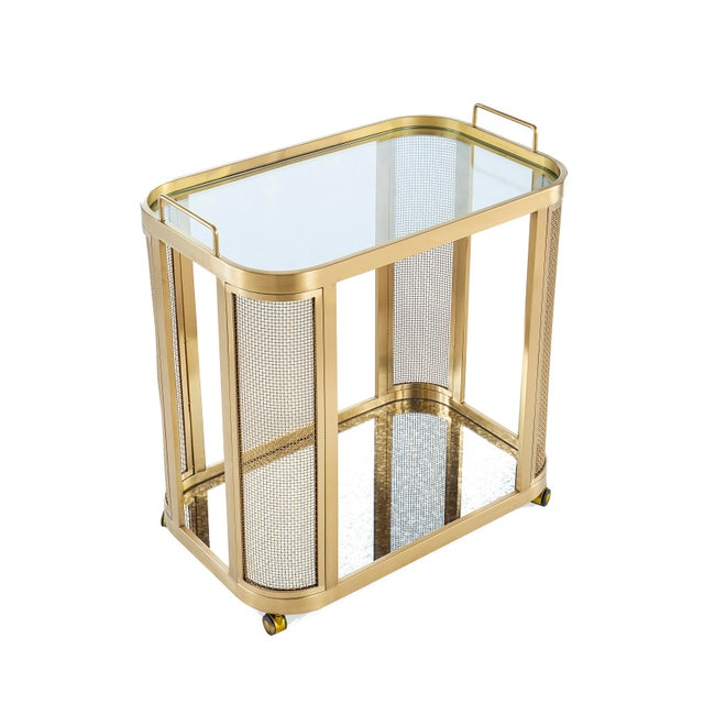 The Irvine Bar Cart is a chic storage solution with industrial, modern flare. Electro-plated in an antique gold over...