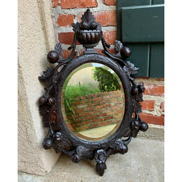 Renaissance 19th Century Antique English Black Forest Style Carved Dark Oak Oval Wall Mirror For Sale - Image 3 of 13