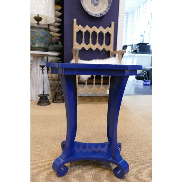 Bright, navy blue side table made of a durable PU lacquer finish, which makes it an easy addition to a well lived-in home....