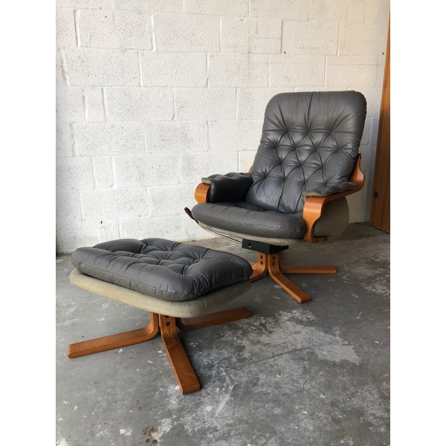 Vintage Mid Century Modern Scandinavian Lounge Chair & Ottoman Attributed to Goten Mobel Sweden Features a unique bentwood...