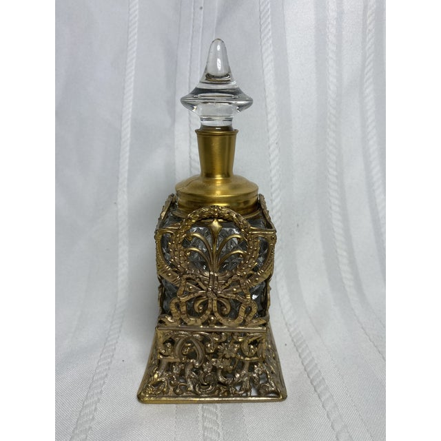 1930s vintage crystal & goldtone metal perfume bottle by Apollo. Art Nouveau style ornate floral detailing on bottle...