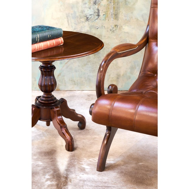 Circa 1850, an exceptional pair of French antique faux side tables. From the Louis Philippe period made of hand-carved...