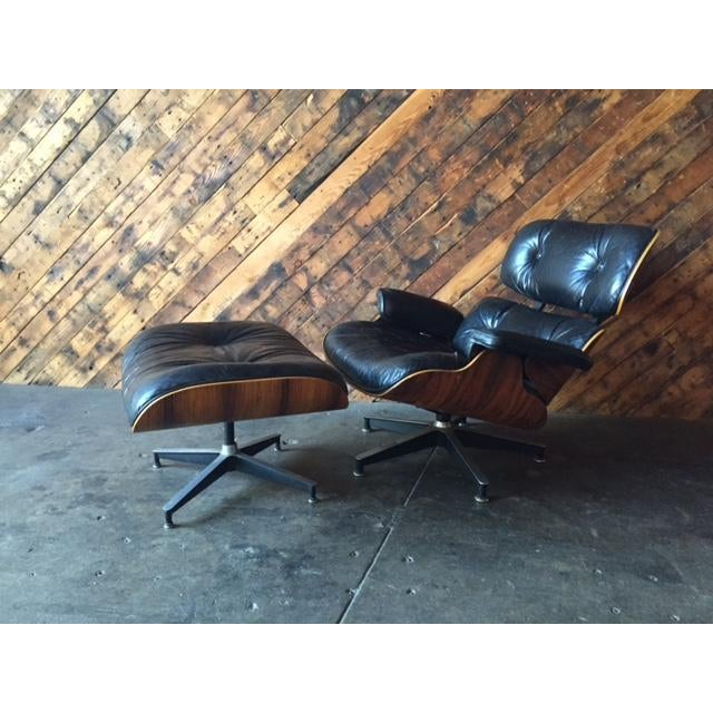 Original Eames Herman Miller 1975 Rosewood Leather Chair with Ottoman dated 1975 with label under chair as shown, Herman...