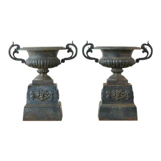 Pair of French Neoclassical Cast Iron Urns on Pedestals For Sale