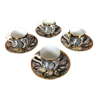 Fornasetti Cammei Oro Gilt Cups and Saucers - Set of 4 For Sale