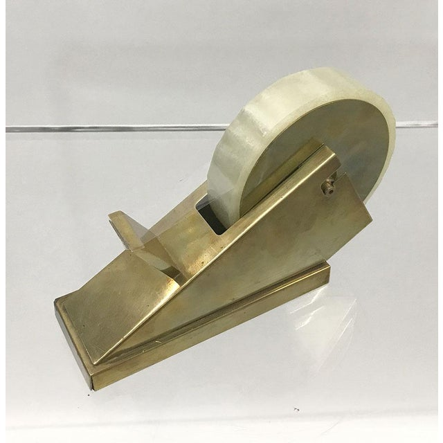 Handsome Mid-Century desk accessory, circa 1970s. Sculptural, modernist form. Brass has aged to a deep, mellow golden...